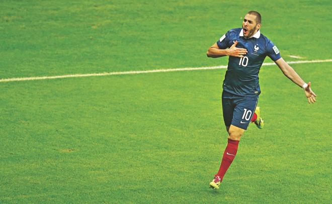 France forward Karim Benzema celebrates after scoring his second goal during their 3-0 victory over Honduras in the World Cup Group E match at the Beira Rio stadium in Porto Alegre yesterday.  PHOTO: REUTERS