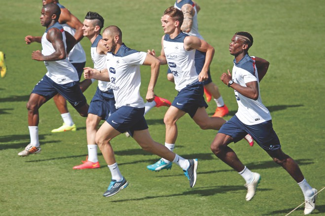 France footballers go through fitness drills during a practice session at the Santa Cruz Stadium in Ribeirao Preto on Wednesday. PHOTO: REUTERS