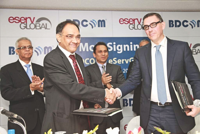 SM Golam Faruk Alamgir, MD of BDCOM Online, and Paolo Montessori, CEO of French IT company eServGlobal, shake hands after signing an agreement to establish a mobile banking services hub in Bangladesh. Photo: BDCOM Online