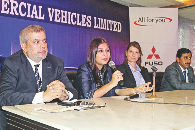 Left, Sohana Rouf Chowdhury, managing director of Ranks Commercial Vehicles, speaks at the launch of Fuso trucks of Daimler India Commercial Vehicles, at Rangs Bhaban in Dhaka yesterday.  Photo: Star