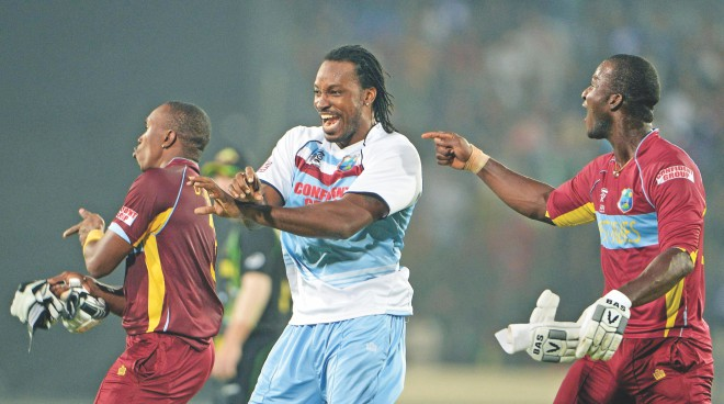 Gangnam came back with the West Indies with Chris Gayle entertaining his captain fantastic Darren Sammy after their win over Australia in Dhaka. Photos: Star File