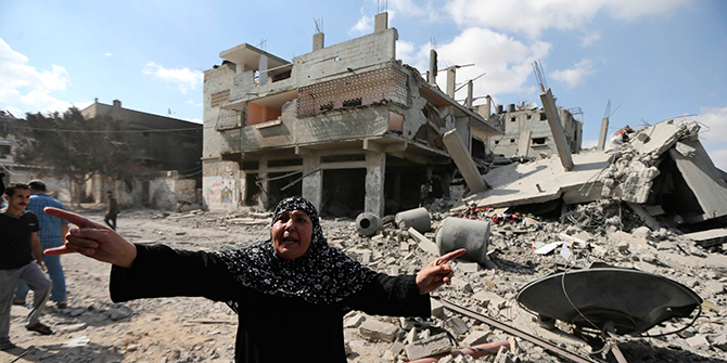 A Palestinian woman reacts as she stands around destroyed houses in the Shejaia neighbourhood, which witnesses said was heavily hit by Israeli shelling and air strikes during an Israeli offensive, in Gaza City July 26. A 12-hour humanitarian truce went into effect on Saturday after Israel and Palestinian militant groups in the Gaza Strip agreed to a UN request for a pause in fighting and efforts proceeded to secure a long-term ceasefire moved ahead. Photo: Reuters