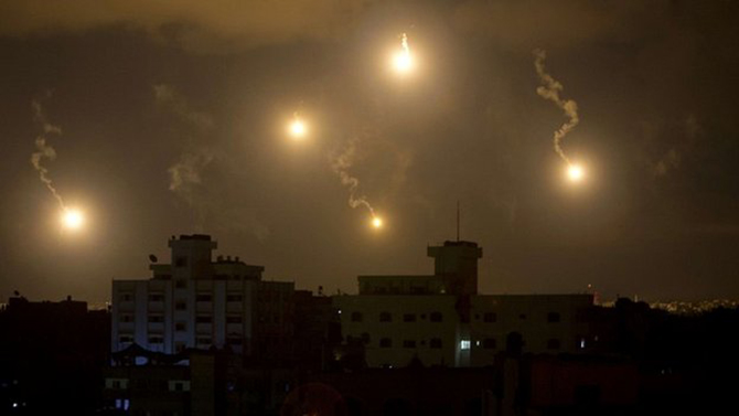 Flares lit up the skies over Gaza on Friday night as Israeli troops continued their fight against Hamas