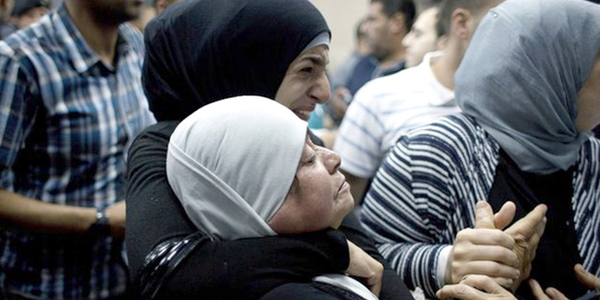 Relatives of injured protestors waited for news of their condition outside Ramallah hospital. Photo: AP