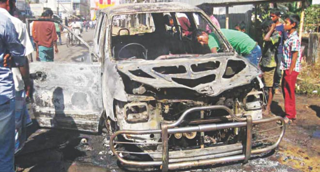 The March 8 photo shows a charred vehicle, which was set on fire during a clash in Sreepur upazila of Gazipur.