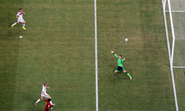 Asamoah Gyan of Ghana scores his team's second goal past goalkeeper Manuel Neuer of Germany during the 2014 FIFA World Cup Brazil Group G match between Germany and Ghana at Castelao on June 22, 2014 in Fortaleza, Brazil. Photo: Getty Images