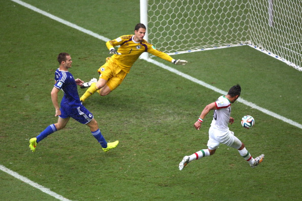 Reza Ghoochannejhad of Iran shoots and scores his team's first goal past goalkeeper Asmir Begovic of Bosnia and Herzegovina during the 2014 FIFA World Cup Brazil Group F match between Bosnia and Herzegovina and Iran at Arena Fonte Nova on June 25, 2014 in Salvador, Brazil. Photo: Getty Images