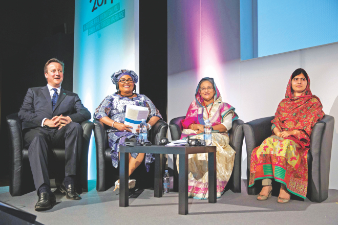 "Prime Minister Sheikh Hasina sits with British Prime Minister David Cameron, left, Chantal Compaore the First Lady of Burkina Faso, and Pakistani rights activist Malala Yousafzai, right, at the ""Girl Summit 2014"" at Walworth Academy in London yesterday.  PHOTO: AFP"