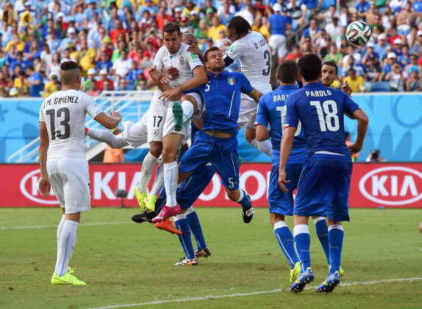 Diego Godin of Uruguay goes up for a header and scores his team's first goal during the 2014 FIFA World Cup Brazil Group D match between Italy and Uruguay at Estadio das Dunas on June 24, 2014 in Natal, Brazil. Photo: Getty Images