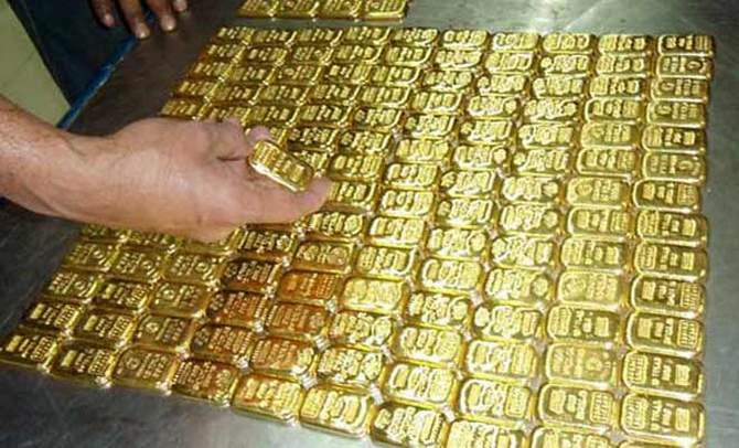 In this November 11 file photo, customs officials display smuggled 320 gold bars that seized at a Biman flight from Dubai at Shahjalal International Airport.