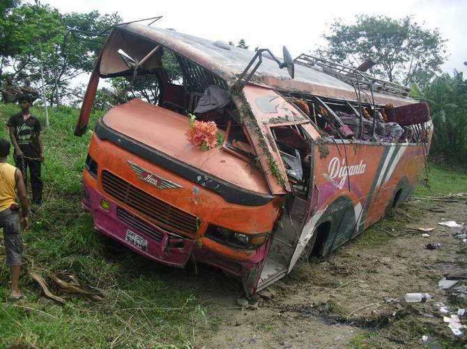The wreckage of the bus that plunged into a roadside ditch on Dhaka-Khulna highway in Kashiani upazila of Gopalganj Saturday. Photo: STAR