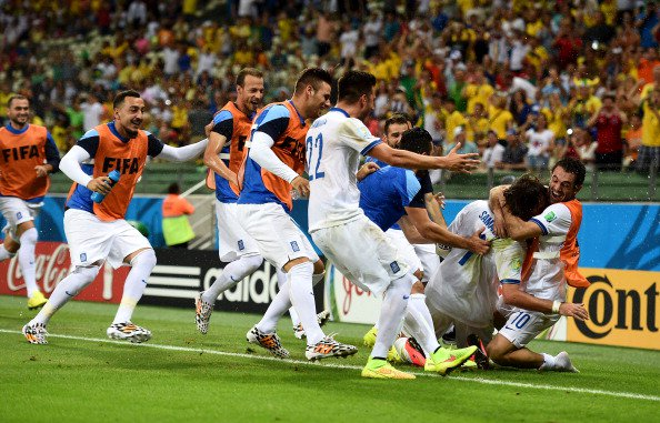 Giorgos Samaras of Greece celebrates with teammates after scoring his team's second goal on a penalty kick during the 2014 FIFA World Cup Brazil Group C match between Greece and the Ivory Coast at Castelao on June 24, 2014 in Fortaleza, Brazil. Photo: Getty Images