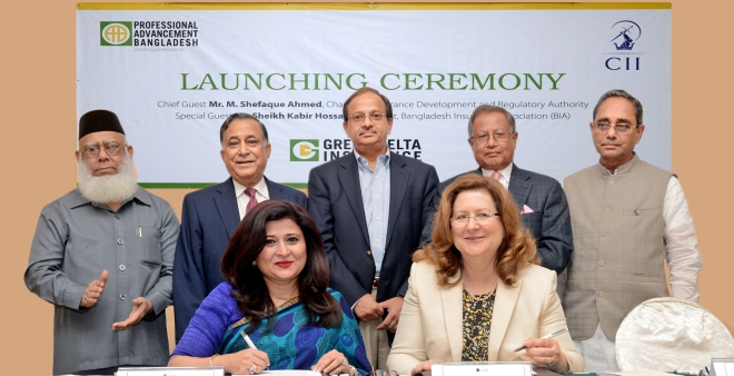 Farzana Chowdhury, managing director of Green Delta Insurance, and Margaret Mary West, head of corporate support of Chartered Insurance Institute, UK, sign a deal at a programme in Dhaka yesterday to offer insurance training courses at the Professional Advancement Bangladesh Ltd launched by Green Delta. Photo: Green Delta