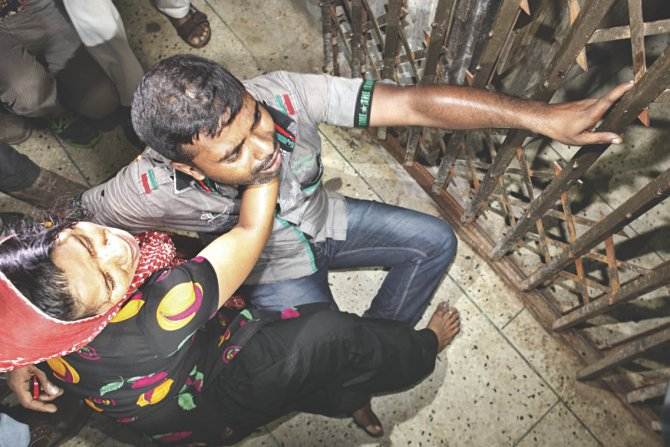 Relatives of the three shot dead at Sonalibagh burst into tears in front of the DMCH room where the bodies were kept last night.  Photo: Rashed Shumon