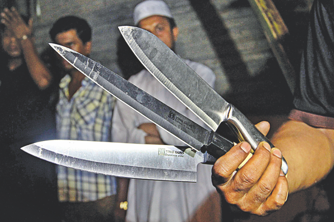 Three knives recovered from the scene. Photo: Anisur Rahman