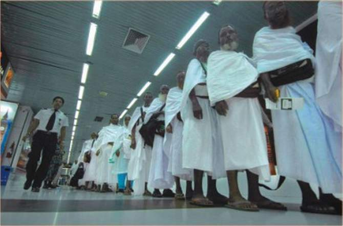 In this September 29, 2011 photo, hajj pilgrims are crossing the boarding bridge at Hazrat Shahjalal International Airport. Biman Bangladesh Airlines carried 505 pilgrims to Saudi Arabia on its first hajj flight this year.