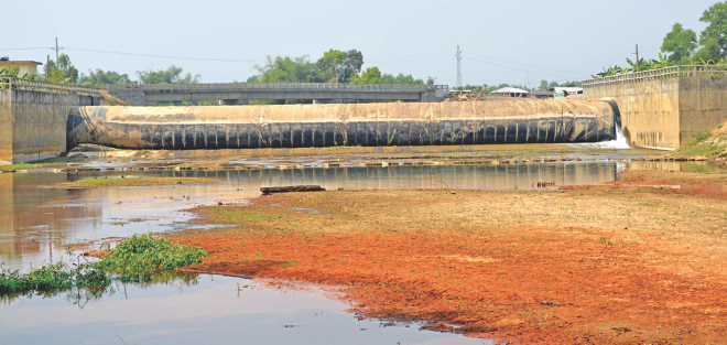 Without conducting any environmental impact assessment, the LGED has built this cross-rubber dam on the Halda river at Bhujpur in Chittagong. The map on the right shows sources, including the dam, which are causing havoc on the river.  Photo: Courtesy