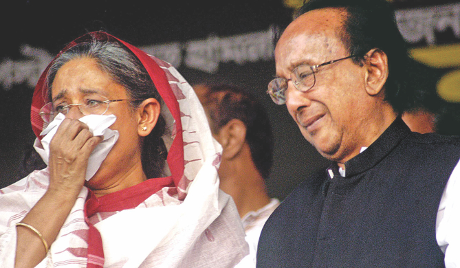 Prime Minister Sheikh Hasina, then leader of the opposition, and late president Zillur Rahman in tears. Zillur lost his wife Awami League leader Ivy Rahman in the grenade attack of August 21, 2004, and Hasina narrowly escaped with injuries. The photo was taken at Paltan Maidan when the two were on stage in October 2004. Photo: File