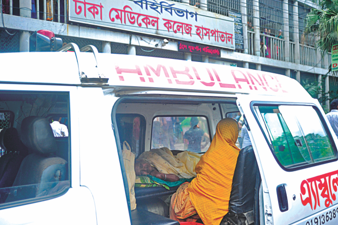 An elderly patient from Manikganj waits inside an ambulance before the outdoor section of DMCH as a doctors' strike sends services into a nosedive. Photo: Firoz Ahmed