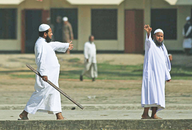 Armed with a stick, a madrasa teacher and Hefajat-e Islam supporter is seen just outside the polling centre at Aljamiyatul Arbiatul Islamia Ziri Madrasa during Hefajat's clash with Awami League men at Patia upazila of Chittagong yesterday. Photo: Anurup Kanti Das