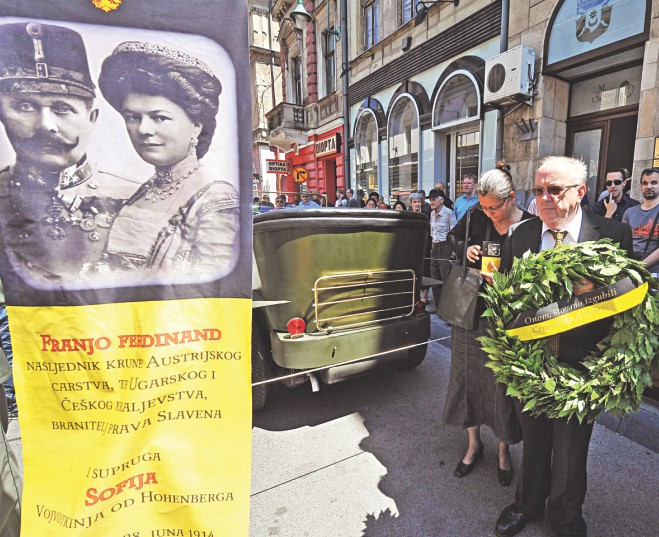 People lay a wreath at the historical street corner where Gavrilo Princip assassinated Austro-Hungarian heir to the throne Archduke Franz Ferdinand and his wife Sofia in Sarajevo, during ceremonies commemorating the 100th anniversary of their assassination, yesterday. Photo: AFP
