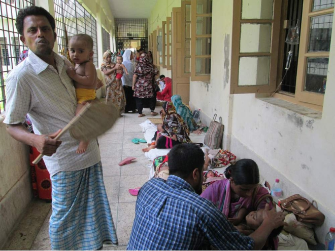 PICTURE TELLS THE TALE: Quite a few child patients are kept on the veranda of Pirojpur Sadar Hospital as its Children's Ward fails to accommodate the increasing number of treatment seekers, amid the ongoing hot spell. The photo was taken on Tuesday noon. PHOTO: STAR