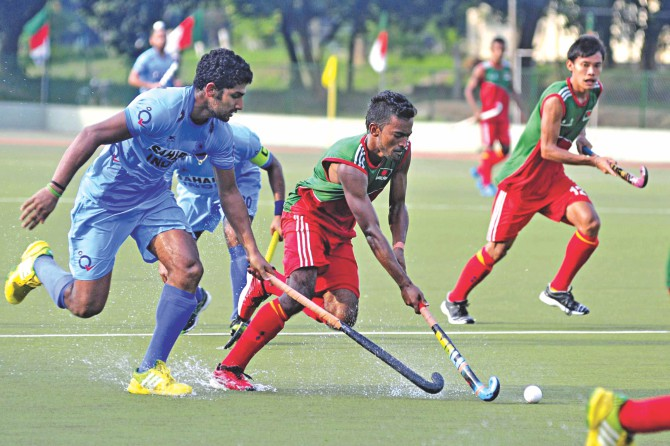 Bangladesh and India players tussle for possession during the first match of the three-match series at the Bangladesh Krira Shikkha Protishthan (BKSP) ground in Savar yesterday. The visitors won the match 2-1. PHOTO: firoz ahmed