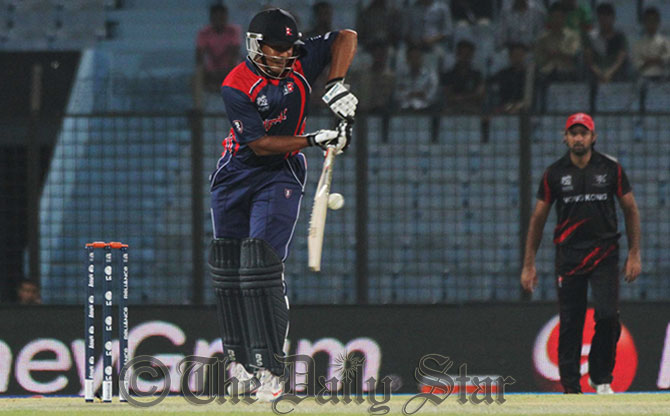 Nepal's top-scorer Gyanendra Malla glances a delivery on his 48-run innings against Hong Kong on the second match of World T20 at Chittagong stadium today. Photo: Anurup Kanti Das