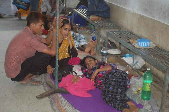 Patients lie on the floor of the diarrhoea ward at Pabna Medical College Hospital because of sudden influx of patients there after Eid. PHOTO: STAR