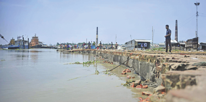 This photo taken recently shows the mighty Padma gobbling up its shores at Mawa in Munshiganj disrupting ferry services and destroying approach roads to pontoons. The erosion here is just the tip of the iceberg. Photo: Firoz Ahmed
