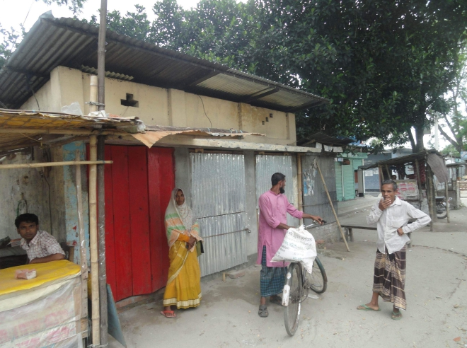 Three illegally built shops make this shed, meant for waiting bus passengers on Lalmonirhat-Burimari road at Milon Bazar in Hatibandha upazila under Lalmonirhat district, virtually unusable for the beneficiaries, thanks to the political clout of a local Awami League leader. PHOTO: STAR