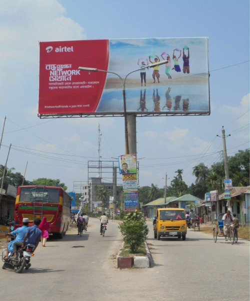 Three illegal billboards, set up on Lalmonirhat- Burimari highway at Mission Intersection in Lalmonirhat town, pose risk of accident anytime. Photo: Star