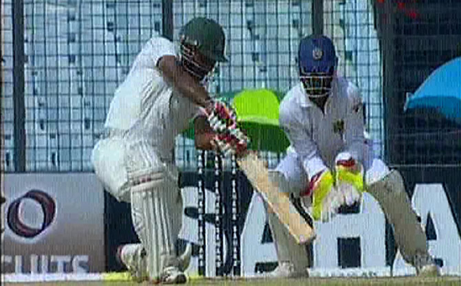 Imrul Kayes hammers a boundary on the off side as he, along with Mominul Haque, steadied Bangladesh after the early fall of both the openers. Photo: TV grab