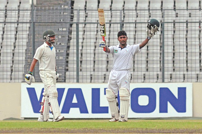 South Zone opener Imrul Kayes celebrates his double hundred against North Zone on the third day of the Bangladesh Cricket League final at SBNS in Mirpur yesterday. PHOTO: STAR