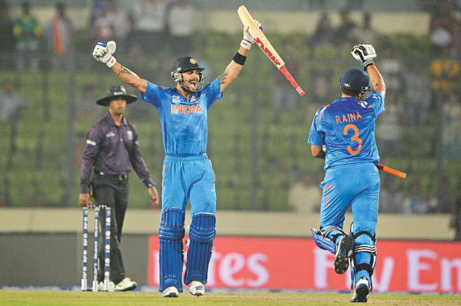 India's Virat Kohli (L) and Suresh Raina celebrate after winning the ICC World Twenty20 Super 10s match against Pakistan at the Sher-e-Bangla National Stadium in Mirpur last night. PHOTO: AFP