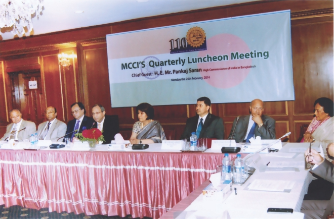 Fourth from left, Pankaj Saran, Indian high commissioner, speaks at a luncheon meeting of the Metropolitan Chamber of Commerce and Industry at the chamber's office in Dhaka yesterday. Rokia Afzal Rahman, MCCI president, and Latifur Rahman, chairman of Transcom Group, were also present. Photo: MCCI