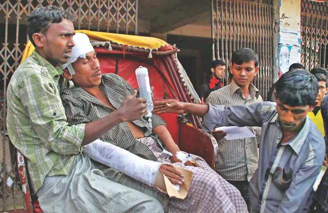 A man being taken to a hospital after Jamaat activists beat him up for going to a polling station to vote in Satkania of Chittagong yesterday. Photo: Anurup Kanti Das