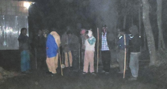 In the face of continued post-election violence against the minority community, Hindu men stand guard at Shafinagar village in Patgram upazila of Lamonirhat on Friday night to prevent further attacks.  photo: star