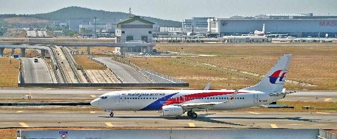 A Malaysia Airlines plane makes its way on the runway at Kuala Lumpur International Airport. Photo: AFP
