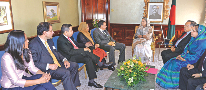 A delegation of the British parliament visits Prime Minister Sheikh Hasina at her Hilton hotel suit on Park Lane on Tuesday.  Photo: PID