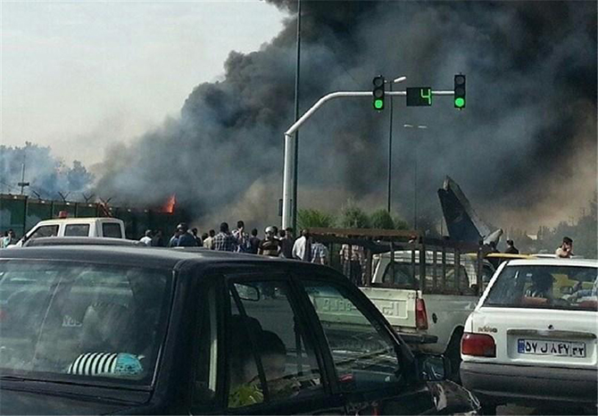 A plane crash in Tehran, Iran's capital city on Sunday morning August 10, 2014. 40 people reported dead so far. Photo Credit: Abas Aslani (@abasinfo)