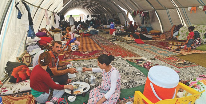 Displaced Iraqi people from the Yazidi community take refuge in a camp near the Turkey-Iraq border at Silopi in Sirnak yesterday. Photo: AFP
