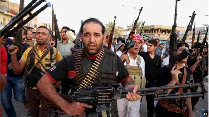 Iraqi Shia tribal fighters deploy with their weapons to help the military, 13 June 2014 They plan to help the military keep ISIS out of Baghdad