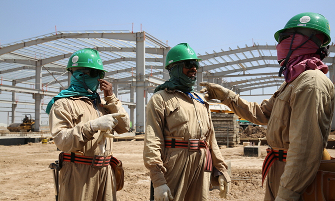 In this undated file photo, workers are seen busy at a national housing programme project called Bismaya New City Project in Baghdad of Iraq.