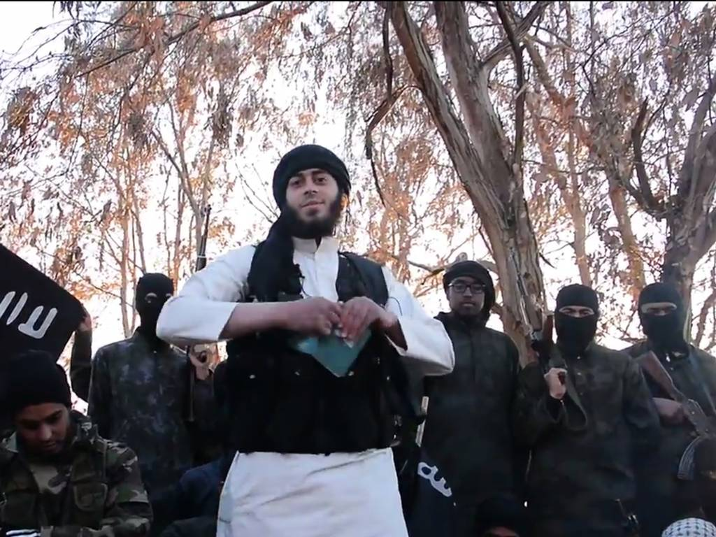 Isis Jihadists burn their passports. Photo: youtube.com
