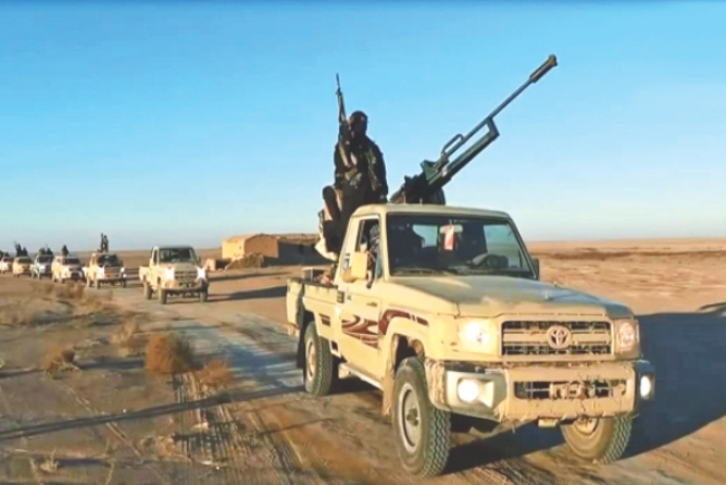 An image grab taken from a propaganda video uploaded yesterday by the Islamic State of Iraq and the Levant allegedly shows militants driving at an undisclosed location in Iraq's Nineveh province. Photo: AFP