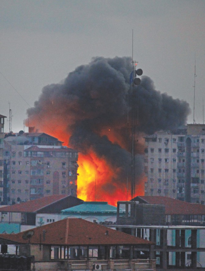 A ball of fire rises from a multi-storey building following an Israeli air strike in Gaza City on Saturday.  Photo: AFP