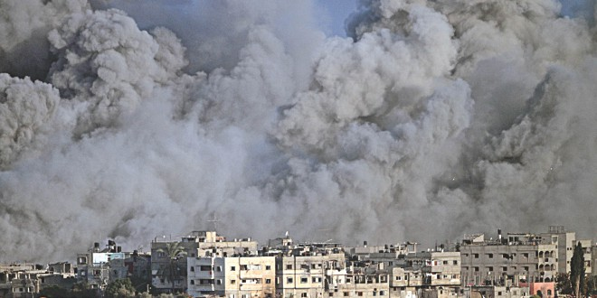 Smoke and debris fill the air during an Israeli strike on Gaza City early yesterday. Photo: AFP