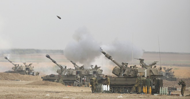 An Israeli artillery fires a 155mm shell towards targets in the Gaza Strip. Photo: AFP