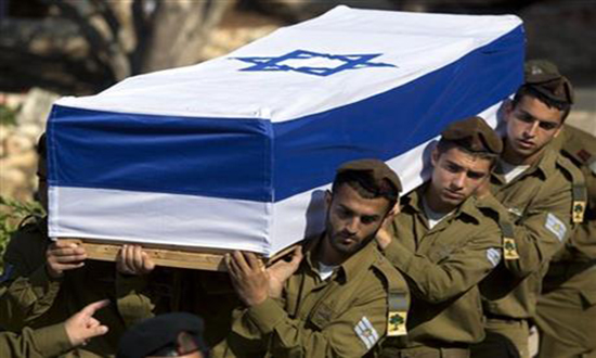 Israeli soldiers carry the coffin of Staff Sgt. Moshe Melako, 20, during his funeral at the Mount Herzel military cemetery in Jerusalem, Monday, July 21, 2014. Melako was one of 13 soldiers killed in several separate incidents in Shijaiyah on Sunday, as Israel-Hamas fighting exacted a steep price, killing scores of Palestinians and more than a dozen Israeli soldiers. In Israel, a country where military service is mandatory for most citizens, military losses are considered every bit as tragic as civilian ones. Photo: AP